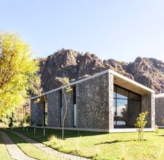 Stone and concrete retreat stands at the foot of Mexican mountain range