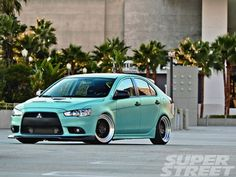 2011 Mitsubishi Lancer Ralliart Sportback. Love the color and front body kit