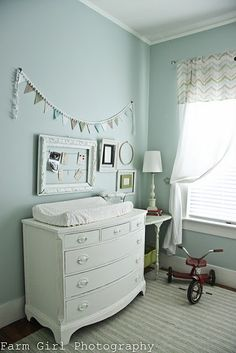 dresser changing table and delicate bunting on robin's egg blue walls - heaven!