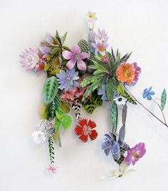 Artist Anne Ten Donkelaar constructs intricate flowerscapes with a collaged combination real pressed flowers and paper floral elements.