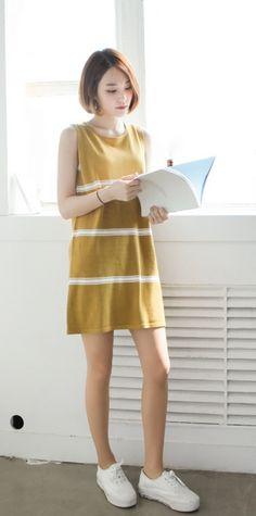 yellow striped dress sleeveless and boxy; white sneakers