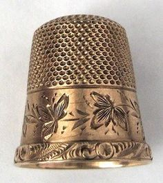 Antiques And Teacups:  14K gold Thimble