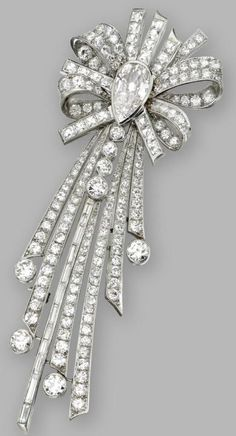 Diamond brooch, Circa 1950.   Centering an antique pear-shaped diamond weighing approximately 1.95 carats, framed by round, old European-cut, single-cut, French-cut and baguette diamonds weighing a total of approximately 10.25 carats.