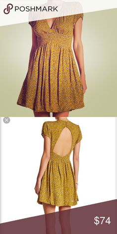 Free People Mini Dress Size L NWT New Free People pretty mini dress size large in Mustard  yellow design. V neck short sleeves back cut out with triple button closure. Smocked waist two side slit pockets all over print and lined. 100% Rayon Free People Dresses Mini