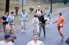 Kathrine Switzer (261) in action as BAA co-director Jock Semple attempts to tear off Switzer's bib during the 1967 Boston Marathon.