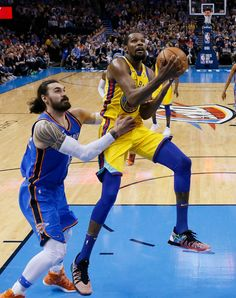 Golden State Warriors forward Kevin Durant, right, goes to the basket in front of Oklahoma City Thunder center Steven Adams during the second half of an NBA basketball game in Oklahoma City, Tuesday, April 3, 2018. (AP Photo/Sue Ogrocki)