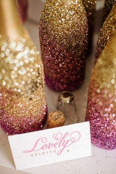 Ombre glitter wedding bottles #weddingideas #DIY goldwedding #weddingbar #reception