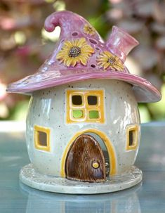 This little pottery fairy house could not be cuter!