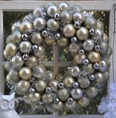 DIY:: Dollar Store Glam Wreath Materials Needed 1-12 inch Styrofoam wreath form 5 tubes (12 each) of Dollar Store ornaments 1 pack of 18 mini ornaments (Joann's Fabrics) Valspars Brilliant Metal Spray Paint Several Yards of Silver Garland Hot glue gun Scissors Wire for hanging (optional)
