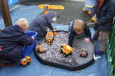 A bag full of gravel from the garden centre and a selection of diggers and trucks will provide hours of imaginative play.