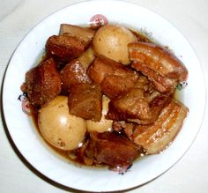 Khâ chrouk Ingredients : 4 Cups water 6 Chicken, duck or quail eggs 1 Tablespoon of water 1 Tablespoon of sugar 2 Cups water 3 Cloves garlic, minced 1 Stalk green onion, minced ¼ Cup fish sauce ¼ Cup sugar ½ Teaspoon salt 2 Cups fresh coconut juice, or 1 canned coconut juice, or 1 can coconut soda 1½ lb Boneless pork meat with skin, pork belly, or lean pork meat cut 2 inches chunks ¼ Teaspoon black pepper