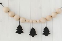 To recreate this modern garland by Liderlamp, hit up the craft store for wooden balls in a variety of sizes, wooden trees, black paint, and black string.