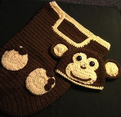 Monkey Cocoon Set $30 Monkey Hats $20 Monkey Hat & Sweater $30-40 Monkey Hat & Diaper Sets $25  Monkey can have ear flaps with braids if you wish.    This set is for 1-6 months. But any size or color can be made.  If you don't see what you like just ask and I can make it. Any color and design. Add ears, flower, bow or animal. Hats from newborn to adult, diaper covers up to 9 months, sweaters up to 2 years.  contact - magicfingers1973@yahoo.ca