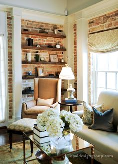 Exposed Brick Decor- for my lil library. I really like the casing for an exposed brick wall Home Living Room, Apartment Living, Living Spaces, Apartment Interior, Apartment Design, White Brick Walls, Exposed Brick Walls, Brick Columns, White Beams