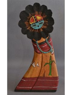 Hopi Sun face Kachina.  A beautiful variation of the typical carving...