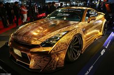 A lamborghini with pink swarvoski crystals, gold engraved Nissan GTR and a car covered with flowers were all featured at this year's auto show.