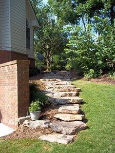 simple way to pave the slope down to the back yard