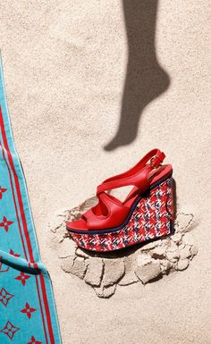 Louis Vuitton: Creating association in the mind of the customer between the beach and the brand. Found an interesting way to show off the straps and heel of the shoe (artistic expression). Evoke feelings of happiness that are associated with summer and the beach. Create a beach scene that appeals to the luxury, high end shopper.