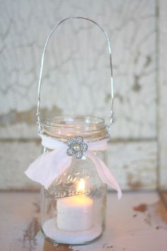 I would like to show you how easy it is to make your own hanging Mason jars! Come on I'll show ya!