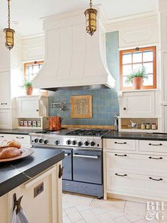 Use backsplash tile to give a new kitchen a historical feel. This kitchen backsplash uses a centerpiece handmade tile in tones of butterscotch to make a statement about a bygone era. A field of blue backsplash tile sets the tile inset apart while drawing all eyes on the range area.