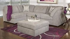 Stylish modular design in a soft, easy-to-maintain knitted upholstery with coordinating accent pillows. Tailored with tufted details on the semi-attached back and extra wide seat.