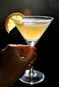 Lemon Drop Martini ~ 2 oz. Citroen Vodka; Juice of 1/2 lemon; 2 heaping tsp. ultra fine sugar for rim of glass.  Shake the vodka with lemon juice and ice in martini shaker, rim glass with sugar, pour & enjoy.