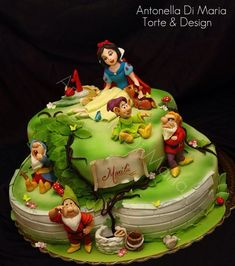 This splendid Snow White Cake was made by Antonella Di Maria Torte & Design. The workmanship and facial on each figure is incredible. Antonella did a terrific job capturing the personality of each dwarf. This Snow White Cake features Snow White, Doc, Sleepy, Grumpy, and Dopey.