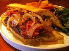 the bifana open-faced steak with caramelized onion panino – bifana is beef tenderloin marinated in the traditional Portuguese style