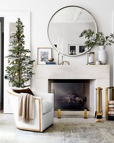Get your hearth holiday ready. Available in a range of quality finishes -- from warm burnished brass to shining polished nickel and classic iron -- our signature fireplace tools deliver scuptural style and heat-resistant functionality. Above Fireplace Decor, Mirror Over Fireplace, Fireplace Mirror, Home Fireplace, Fireplace Remodel, Living Room With Fireplace, Fireplace Design, Living Room Decor, Fireplace Tools