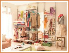 Good idea for fashion truck layout, using pallets slat walls with salvaged pipes and fittings for garment hanging bars