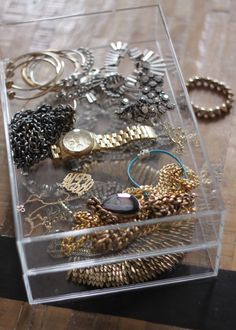 Lovely way to store often-used jewelry - acrylic trays from Container Store #cheetahisthenewblack