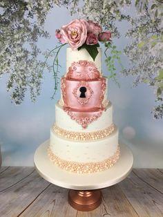 Fairytale rose gold lock wedding cake  by Melanie Jane Sowa - http://cakesdecor.com/cakes/243674-fairytale-rose-gold-lock-wedding-cake