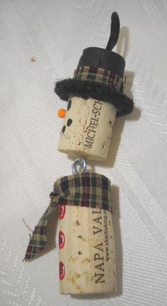 Christmas DIY: A snowman ornament m A snowman ornament made of two recycled wine corks. His hat brim is made of felted wool and he sporst a plaid hat band and scarf. Measures about 4 inches not including hanger Christmas Projects, Holiday Crafts, Christmas Diy, Christmas Decorations, Christmas Ornaments, Snowman Ornaments, Snowman Crafts, Disney Christmas, Spring Crafts