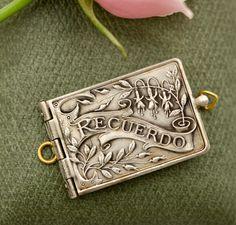 Antique Recuerdo (Memory) Souvenir Locket w/ Accordion Photos, French made by ParisHotelBoutique on Etsy https://www.etsy.com/listing/477527085/antique-recuerdo-memory-souvenir-locket