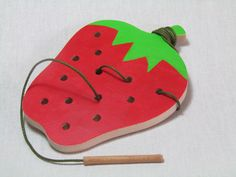 Wood Sewing game - Strawberry, Educational toy, Toddler toy by Tinocchio on Etsy https://www.etsy.com/listing/157928533/wood-sewing-game-strawberry-educational