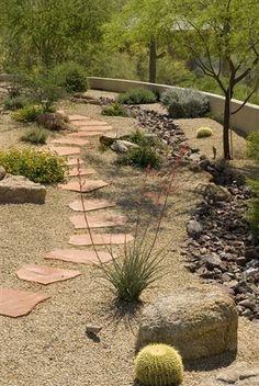 pathway Side yard with drainage trench drain rocks Rainwater harvesting