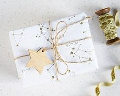 Golden Star Constellations Wrapping Paper Set by Newton and the Apple, the perfect gift for Explore more unique gifts in our curated marketplace. Christmas Swags, Christmas Balls, Christmas Decorations, Christmas Ideas, Unique Christmas Gifts, Christmas Gift Wrapping, Christmas Presents, Triquetra, Erin Condren