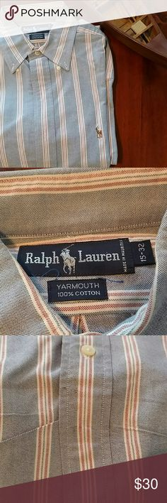 Ralph Lauren Blue Label Yarmouth button down 15-32 This is an Oxford blue shirt with red and white vertical stripes size 15-32.  A vintage Ralph Lauren Blue Label Yarmouth, this has been in closet storage for a decade.  Appears in great condition with the exception of some minor discoloration below the bottom button as shown in the photos.  The Yarmouth has a slightly more relaxed fit than the RL classic fit. Ralph Lauren Shirts Dress Shirts