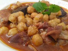 I know Málaga: Tripe with chickpeas to Malaga not tripe as we know it but parts of meat we don't usually use in the U.S. 1 Kg of Malaga chickpeas (or garbanzo beans) 3 pork bellies 1 pork tongue Three trotters 1 pigtail