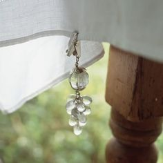 Great idea for tablecloth weights for outdoor dinner parties.  Look for old chandelier pieces at antique stores & add the clip.