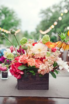 Bold Flowers in Rustic Container | photography by http://jnicholsphoto.com/