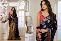 Superb Designer Party wear Mustard and Navy Blue Georgette saree with Georgette Jacquard Pallu and Contrast matching Jute Net Blouse. Heavy work en-crafted all over.