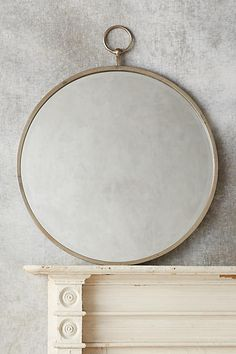 """Antropologie--Hoop Mirror, 36.5 H x 30"""" w , $248.  two finishes, carbon (shown) & bronze (goldish)"""