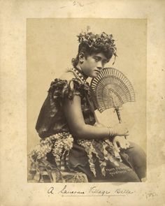 Portrait of a taupo, a young Samoan village maiden, taken in the 1890s by Thomas Andrew of Apia, Western Samoa.