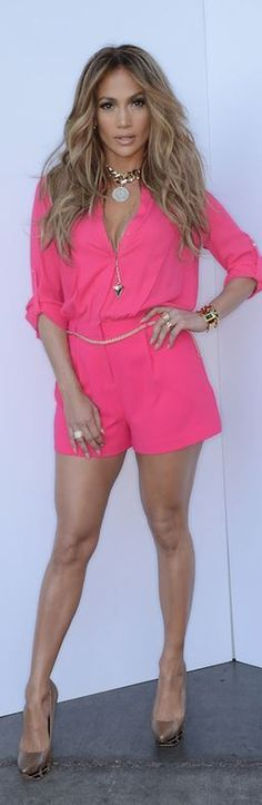 #partywear | Jennifer Lopez in a hot pink Kohl's romper paired with gold chunky necklace and bracelet.