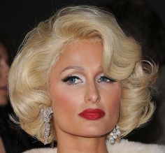 This is the Most Glam Paris has ever looked lol  Paris Hilton Bob  Paris channeled her inner Marilyn and rocked a retro platinum bob while dripping in diamonds and sporting bold red lipstick.