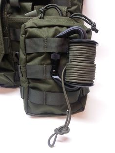 CARABINER REEL: The Carabiner Reel or Spool is specifically designed to give the operator a length of line to conduct remote pull operations on suspicious packages, IED's, trip wires or any other hazardous item that just needs to be moved remotely.  Easy to clip on to your MOLLE gear or pull tab on your favorite pouch.