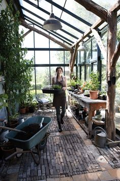 the most spectacular greenhouse! look at those wood beams and that incredible floor!
