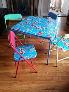 Recovered kids table chair set with oil cloth. need to do this with our set that just sits in the garage