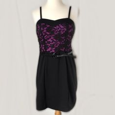 💜NWT black n' purple belted dress💜 This adorable dress has a lacy purple top with black belt and bottom. The bottom fabric has spandex in it for easy fitting. The straps are adjustable and belt could be removed. Lily Rose Dresses